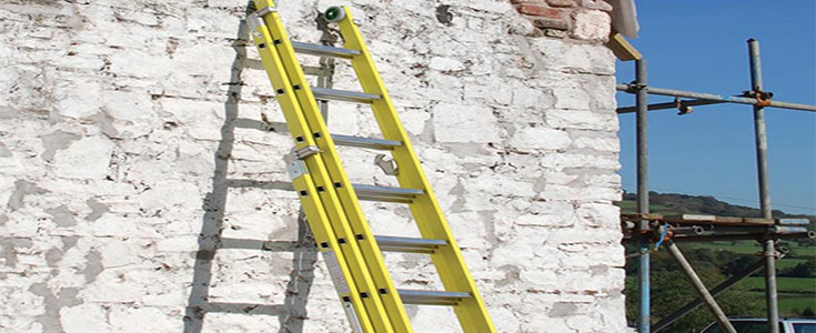 Fibreglass ladders against a stone wall
